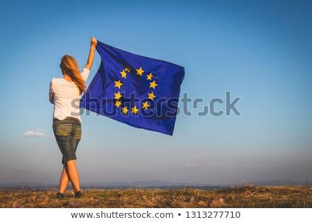 Cheerful woman holding European flag Stock photo © photography33