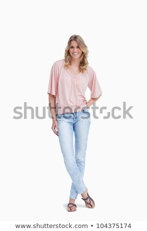 mosolygó · nő · áll · lábak · keresztbe · fehér · boldog · háttér - stock fotó © wavebreak_media