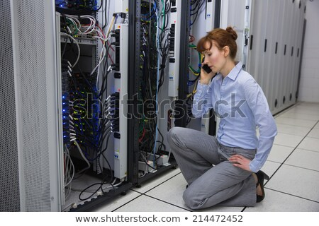 Technician phoning while repairing the server Stock photo © wavebreak_media