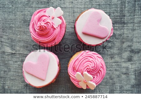 Four valentines cupcakes with heart decorations Stock photo © wavebreak_media
