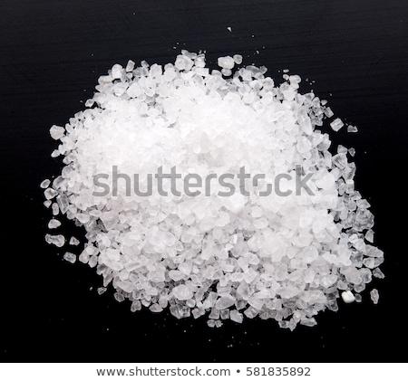 Salt on black background Stock photo © deyangeorgiev