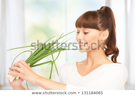 beautiful housewife with spring onions Stock photo © dolgachov