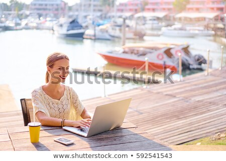 woman with laptop on quay Stock photo © ssuaphoto