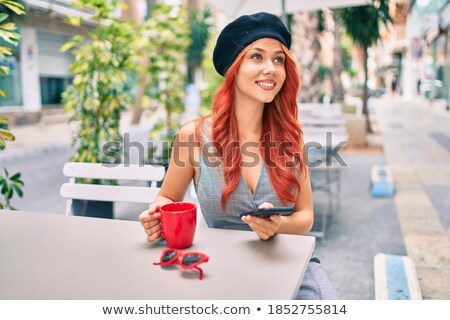 happy redhead women sitting at a coffee table with shopping bags Stock photo © Rob_Stark