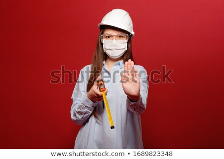 Female Builder With Danger Tapes Stock photo © Voysla