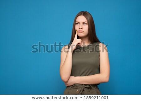 Beautiful brunette in greend dress standing near the wall Stock photo © Nejron