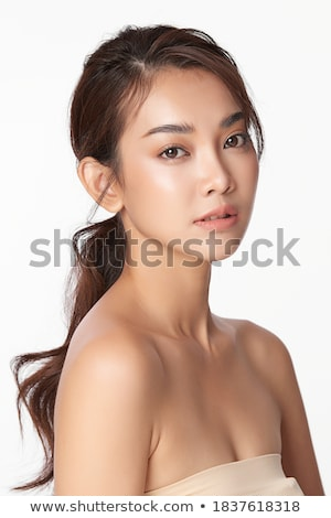 Closeup portrait of a young beautiful asian model with makeup and jewelry Stock photo © deandrobot