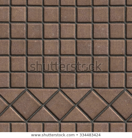 Brown Pave Slabs in the Form of Small Squares and Triangles. Stock photo © tashatuvango