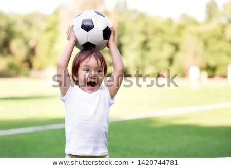 standing toddler with balls stock photo © phbcz