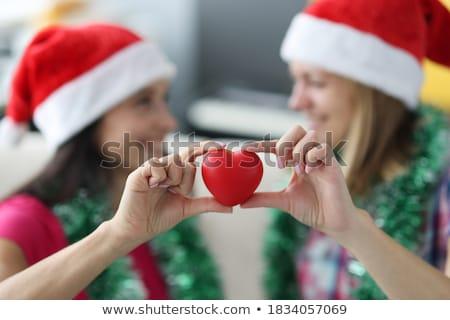 Közelkép boldog leszbikus pár piros szívek Stock fotó © dolgachov