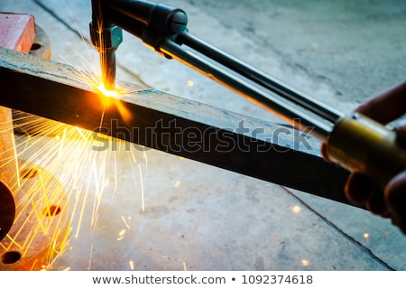 Gas cutting of the hot metal in a plant Stock photo © mady70