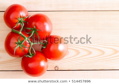 Five medium tomatoes over unfinished wooden planks Stock photo © ozgur