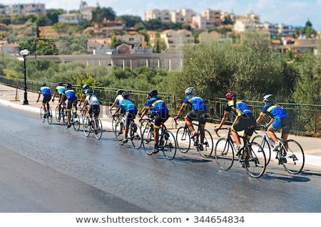 Grupo ciclista rua raça estrada cidade Foto stock © smuki