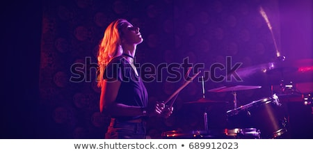 Beautiful drummer performing in illuminated nightclub Stock photo © wavebreak_media
