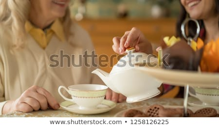 Mother and daughter pouring tea in the cups Stock photo © wavebreak_media