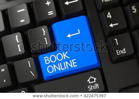 keyboard with blue key   online booking stock photo © tashatuvango