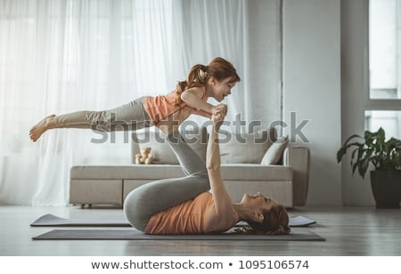 Mother and daughter lying on rug Stock photo © IS2