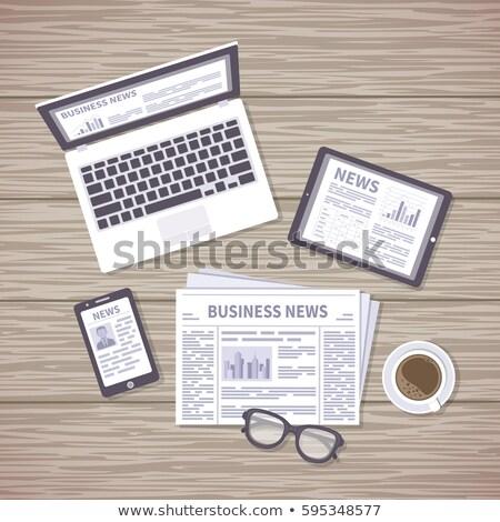 a newspaper on a wooden desk   world politics stock photo © zerbor