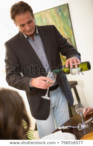 man serving white whine stock photo © is2