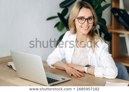 Blonde secretary working at laptop Stock photo © studioworkstock