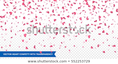 Heart confetti of Valentines petals falling on red background. Flower petal in shape of heart confet Stock photo © olehsvetiukha