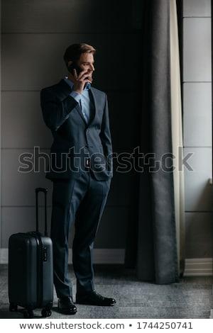 深刻 · ビジネスマン · 立って · 話し · 携帯電話 · オフィス - ストックフォト © traimak