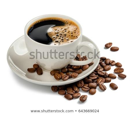 Café noir tasse soucoupe fraîches grains de café noir Photo stock © DenisMArt