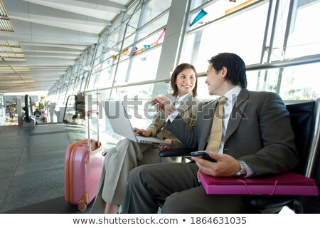 image of cheerful businessman 30s in suit smiling while holding stock photo © deandrobot