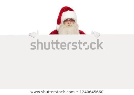 saint nick wearing sunglasses and santa costume holds white bill Stock photo © feedough