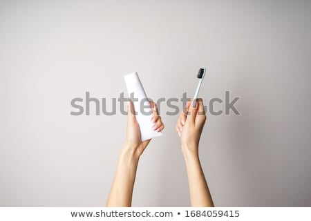 Woman's Hand Protecting White Tooth Stock photo © AndreyPopov