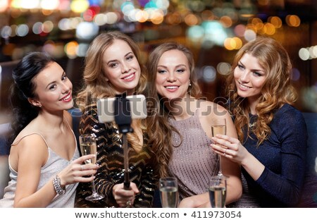 women taking picture by selfie stick at wine bar Stock photo © dolgachov