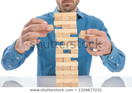 casual dressed man playing a game of jenga Stock photo © feedough
