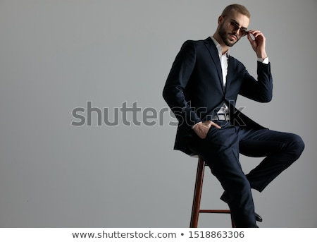 blonde guy with sunglasses with hand in pocket Stock photo © feedough