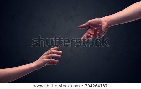 Two male hands on an empty background Stock photo © konradbak