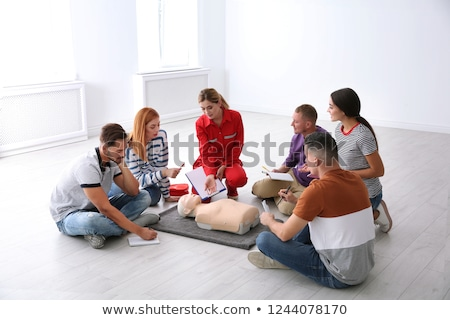 Woman in first aid course training reanimation Stock photo © Kzenon
