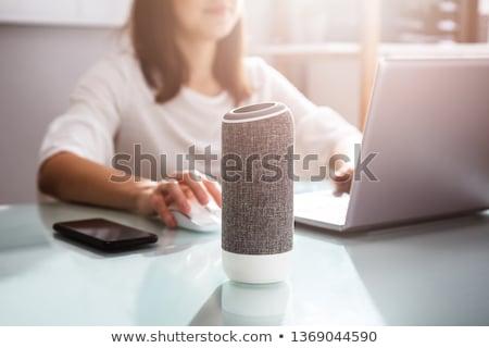 Femme voix assistant bureau souriant jeune femme Photo stock © AndreyPopov