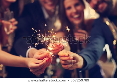 happy couple with sparklers at party Stock photo © dolgachov