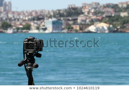 Action camera on a tripod records a video of the time-lapse of a big city Stock photo © galitskaya