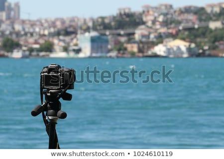 Action camera on a tripod records a video of the time-lapse of a big city Stock photo © galitskaya