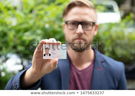 Bailiff standing at entrance showing id Stock photo © AndreyPopov