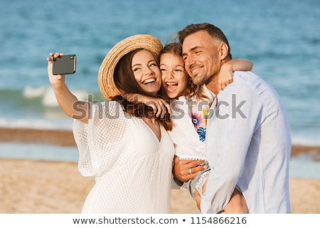 Stock photo: family taking selfie by smartphone on autumn beach