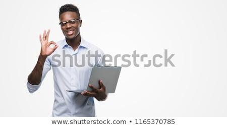 OK african man businessman. hand gesture okay. success good Stock photo © studiostoks