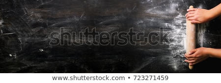 Raw dough for bread with ingredients on black background Stock photo © Freedomz