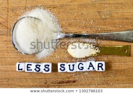 Cukrzyca słowo łyżka cukru tabeli tle Zdjęcia stock © AndreyPopov