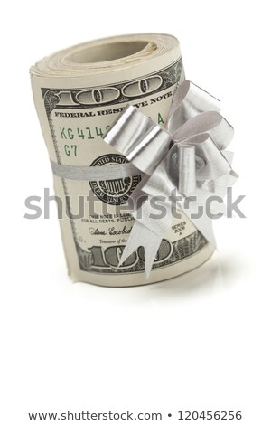 Roll of One Hundred Dollar Bills With Silver Bow on White Stock photo © feverpitch