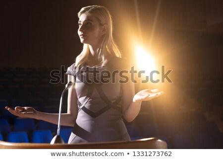 Front view of blonde Caucasian businesswoman practicing for speech in the auditorium Stock photo © wavebreak_media