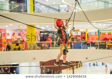 Adorable little boy enjoying his time in climbing adventure park in the mall BANNER, LONG FORMAT Stock photo © galitskaya