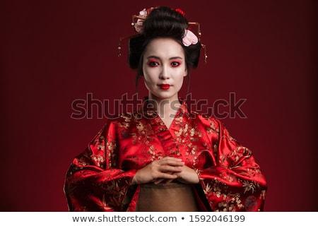 Image of cheerful geisha woman in traditional japanese kimono sm Stock photo © deandrobot