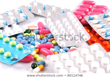Pills of many shapes and colors grouped together Stock photo © nenovbrothers