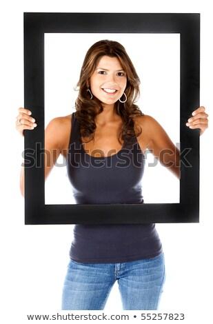 Foto stock: Pretty Woman Holding Frame